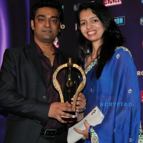 Kunal Pandya and Purvi Pandya of NCrypted receiving the International Quality Crown Award at London Convention, 2012